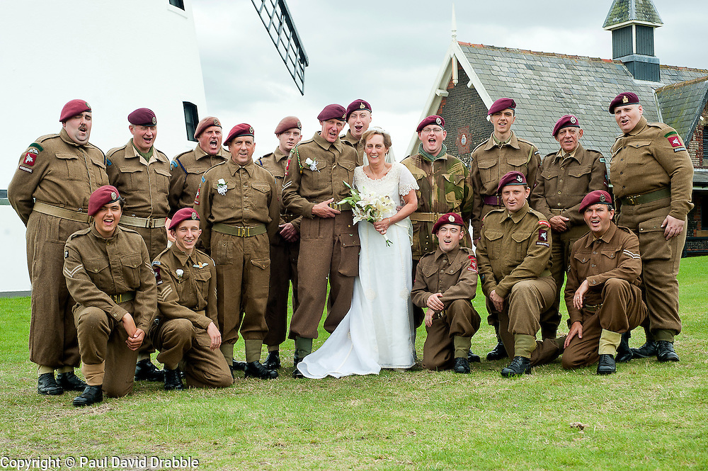 Bride and groom Andy and Kath Hacking surrounded by the Northern World War 2 Associations 6th Airborne Group. Both are members of the  Northern World War 2 Association and the happy couple chose to tie the knot surrounded by family and friends during the Lytham 1940's war weekend.19 August 2011  Image © Paul David Drabble.
