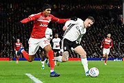 Djed Spence (29) of Middlesbrough battles for possession with Joe Bryan (23) of Fulham during the EFL Sky Bet Championship match between Fulham and Middlesbrough at Craven Cottage, London, England on 17 January 2020.