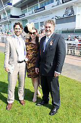 Left to right, DOUGRAY SCOTT, CLAIRE FORLANI and RAYMOND VAN NIEKERK Global Head of Marketing at Investec at the Investec Ladies Day at Epsom Racecourse, Surrey on 4th June 2010.
