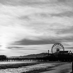 Santa Monica Pier at sunset along the Pacific Ocean in Southern California. Black and white panorama photo ratio is 1:3. Copyright ⓒ 2017 Paul Velgos with All Rights Reserved.
