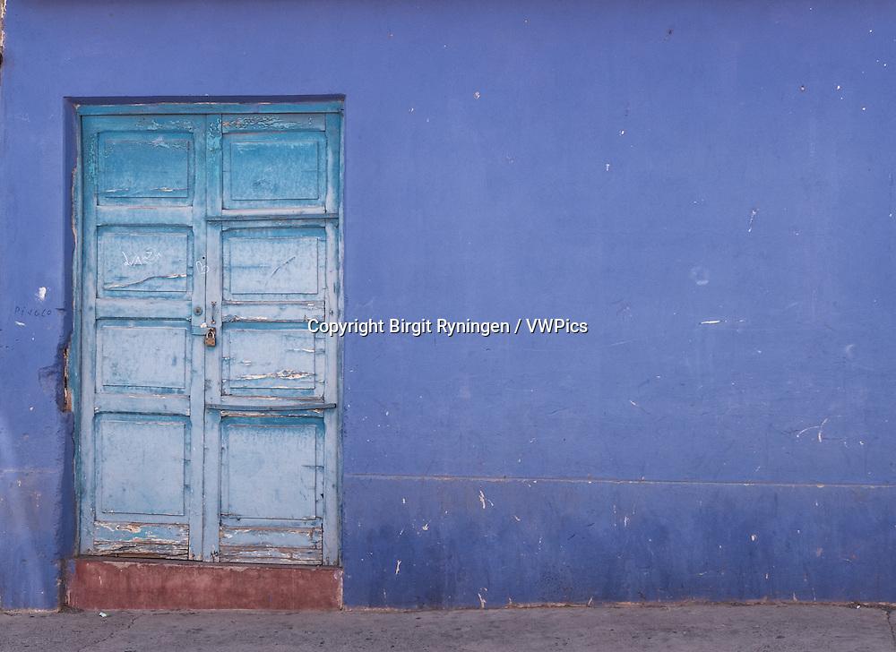 Blue door, blue wall