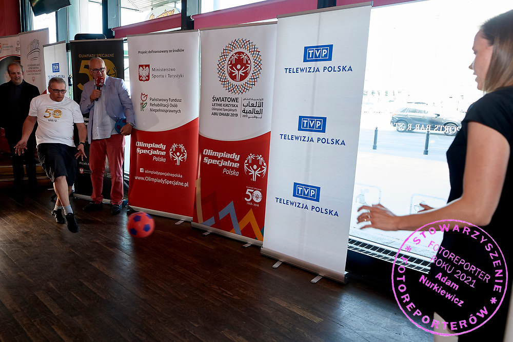 Warsaw, Poland - 2018 May 10: Special Olympics Athete Adam Jaczewski shoots on goal and (R) Maria Ptak saves while Special Olympics Press Conference at Marriott Champions Sport Bar on May 10, 2018 in Warsaw, Poland.<br /> <br /> Adam Nurkiewicz declares that he has no rights to the image of people at the photographs of his authorship.<br /> <br /> Picture also available in RAW (NEF) or TIFF format on special request.<br /> <br /> Any editorial, commercial or promotional use requires written permission from the author of image.<br /> <br /> Image can be used in the press when the method of use and the signature does not hurt people on the picture.<br /> <br /> Mandatory credit:<br /> Photo by &copy; Adam Nurkiewicz / Mediasport