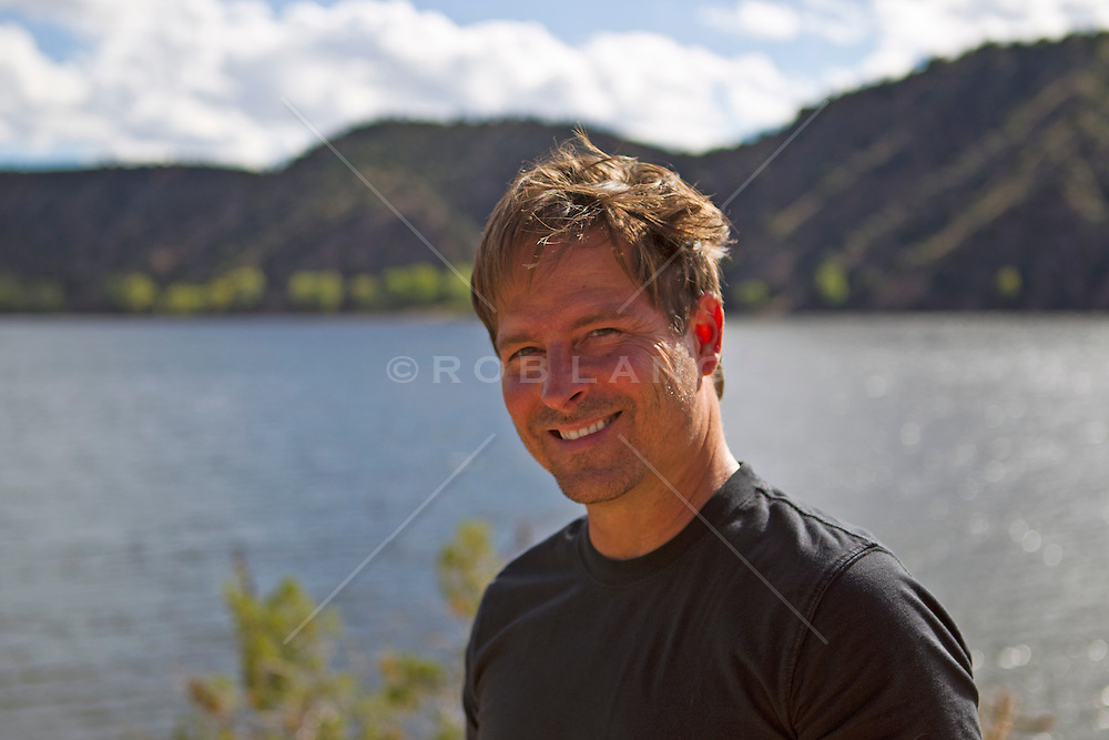good looking man by a lake in New Mexico
