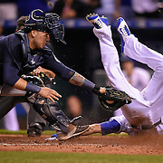 Kansas City Royals right fielder Paulo Orlando (16) scored the winning run past the tag of Seattle Mariners catcher Jesus Sucre (2) on September 23, 2015 at Kauffman Stadium in Kansas City, Mo. The Royals won 4-3 in 10 innings.