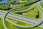 Nederland, Noord-Brabant, Den Bosch, 13-05-2019; Knooppunt Empel, half turbineknooppunt. Het knooppunt is onderdeel van de Ring 's-Hertogenbosch en verbindt rijksweg A59 (in westelijke richting) met rijksweg A2 (Noord-Zuid). <br /> Empel junction, near Den Bosch.<br /> <br /> aerial photo (additional fee required); luchtfoto (toeslag op standard tarieven); copyright foto/photo Siebe Swart