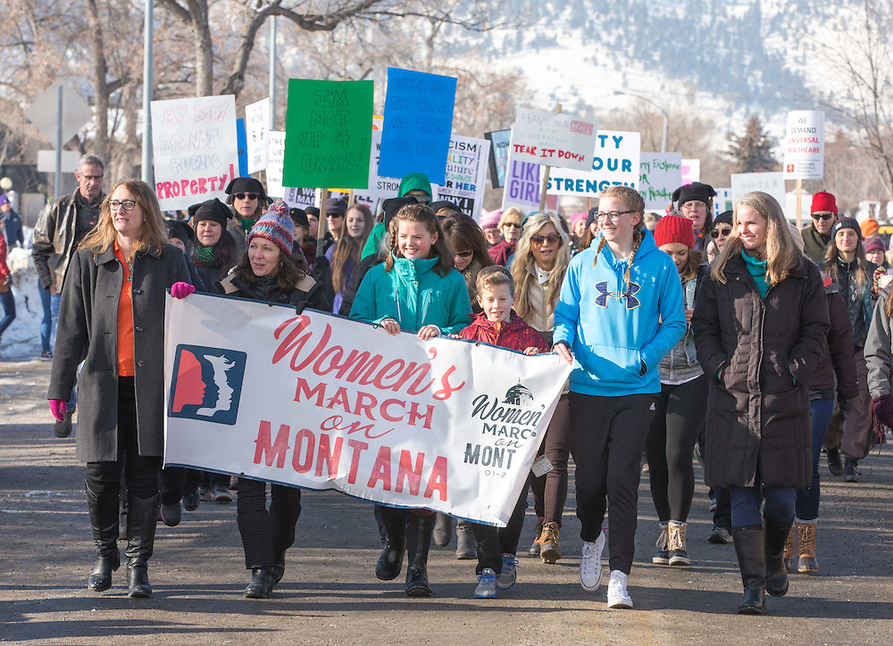 Montana First Lady Lisa Bullock walks with the crowd at the start of the Women's March Montana Rally at the State Capitol building in Helena, Montana.