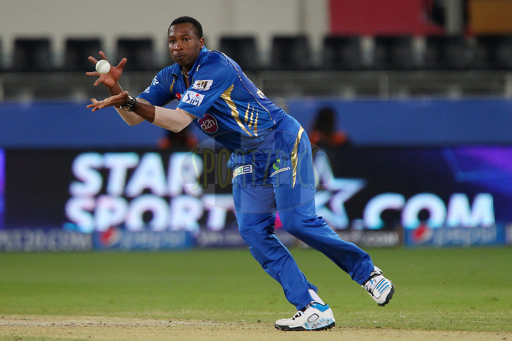 Kieron Pollard of the Mumbai Indians takes the return ball from David Warner of the Sunrisers Hyderabad during match 20 of the Pepsi Indian Premier League Season 2014 between the Mumbai Indians and the Sunrisers Hyderabad held at the Dubai International Stadium, Dubai, United Arab Emirates on the 30th April 2014<br /> <br /> Photo by Ron Gaunt / IPL / SPORTZPICS