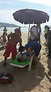 """Phuket lifeguards at Patong blame stingray for injured Chinese tourist, doctors say crabs<br /> <br /> Lifeguards at Patong Beach believe that a Chinese tourist was injured by a stingray while swimming at the busy Phuket beach<br /> <br /> The tourist, 28-year-old Li Guangwei, from Guangdong, shouted for help at about 3pm after he felt a stabbing pain in his left foot while swimming in front of the Banana Walk mall on Thaweewong Rd.<br /> Lifeguards brought him ashore and provided first aid.<br /> <br /> """"He had a hole in his foot and was bleeding. He was very frightened,"""" one lifeguard told The Phuket News.<br /> <br /> """"He even had difficulty breathing. We provided first aid and Kusoldharm rescue workers took him to Patong Hospital.""""<br /> <br /> """"Mr Li said he didn't see a what caused the injury, but we believe that it might be a stingray,"""" the lifeguard added.<br /> <br /> """"Stingrays like to dig into the sand in shallow water after it has rained and when the sea water is muddy and swirling,"""" he said.<br /> <br /> """"Last year one tourist was injured by a stingray, and Mr Li is the first person this year,"""" the lifeguard said.<br /> <br /> Sen Sgt Maj Phudit Nguanson of Phuket Tourist Police stationed at the beach end of Bangla Rd attended to Mr Li at the hospital.<br /> <br /> """"Mr Li is safe. His doctor told us that Mr Li was injured by marine life, which they believe was likely to have been a horseshoe crab,"""" he said.<br /> <br /> """"Doctors gave him an injection and and made sure he was feeling well enough before discharging from hospital. He has since returned to his accommodation,"""" Sen Sgt Maj Phudit said.<br /> ©Exclusivepix Media"""