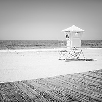 Laguna Beach California Lifeguard Tower black and white photo with a wooden boardwalk at Main Beach. Laguna Beach is a beach community along the Pacific Ocean in Orange County Southern California.