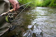 Fly fishihg rod and reel on the river.