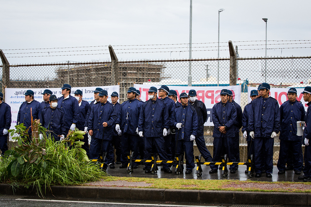 OKINAWA, JAPAN - NOVEMBER 14:  Japanese police are seen in front of the gate of U.S. base ‎Camp Schwab in Henoko during a protest against the construction of the new U.S base in Nago, Okinawa prefecture, Japan on November 14, 2015. (Photo: Richard Atrero de Guzman)