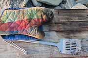Oven mitt and spatula at a cookout on the beach, Little Compton, Rhode Island.