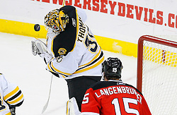 Dec 23, 2008; Newark, NJ, USA; Boston Bruins goalie Tim Thomas (30) makes a save during the second period at the Prudential Center.