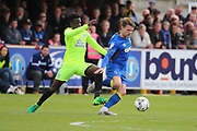 Peterborough United midfielder Leo (Leonardo) Da Silva Lopes (18) battles for possession with AFC Wimbledon midfielder Jake Reeves (8) during the EFL Sky Bet League 1 match between AFC Wimbledon and Peterborough United at the Cherry Red Records Stadium, Kingston, England on 17 April 2017. Photo by Matthew Redman.