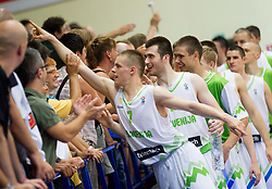 Klemen Prepelic of Slovenia, Marko Pajic of Slovenia, Jaka Brodnik of Slovenia celebrate after the basketball match between National teams of Slovenia and Lithuania in First Round of U20 Men European Championship Slovenia 2012, on July 14, 2012 in Domzale, Slovenia. Slovenia defeated Lithuania 87-81. (Photo by Vid Ponikvar / Sportida.com)