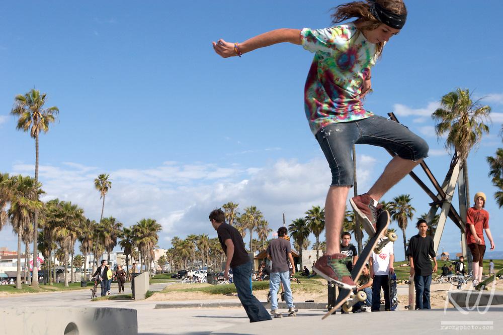 Teen Skater Jumps Off Wall, Venice Beach, California