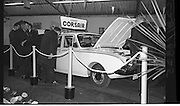 "Launch Of New Ford Corsair..1963..01.10.1963..10.01.1963..1st October 1963..Today saw the launch of a new car to the market. At the Smithfield Motor Company in Drumcondra, Ford launched ""The Corsair"".,The Corsair was one of the four model Consul range, and shared many of its mechanical components with the Cortina, Classic and Capri. The Corsair had unusual and quite bold styling for its day, with a sharp horizontal V-shaped crease at the very front of the car into which round headlights were inset...Picture shows prospective buyers getting a close up view of the Corsair on the display stand at the Smithfield Motor Company, Drumcondra."