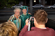Students stop for photos before heading home following the Chaminade Julienne High School Class of 2012 commencement exercises at the Schuster Center in downtown Dayton, Monday, May 21, 2012.