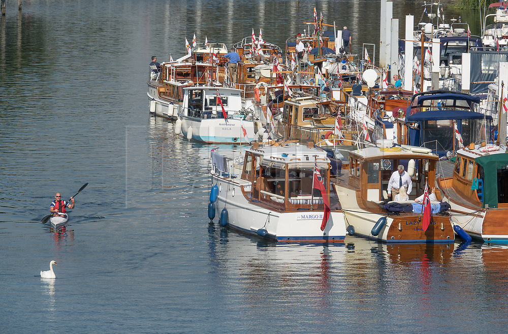 © Licensed to London News Pictures. 02/09/2017. Hampton Court, UK. A flotilla of Dunkirk 'Little Ships' are moored on the River Thames near Hampton Court before taking part in The Veterans Cruise along the river. A period of warmer weather is predicted over the next few days after the recent wet spell. Photo credit: Peter Macdiarmid/LNP