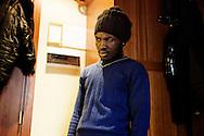 Napoli, Italia - 12 febbraio 2012. Mohammed, 26 anni, ghanese, ritratto nella stanza di albergo in cui vive a Napoli. Mohammed e sbarcato sull'isola di Lampedusa (imbarcato a Tripoli) lo scorso maggio ed e ancora in attesa di essere giudicato dalla Commissione Territoriale per il Riconoscimento della Protezione Internazionale per ricevere lo status di rifugiato..Ph. Roberto Salomone Ag. Controluce.ITALY - Mohammed, 26, from Ghana, portrayed in the hotel room he lives in, in Naples on February 12, 2012. Mohammed arrived on the italian island of Lampedusa on May 2011 leaving from Tripoli and is still waiting to receive the refugee status.