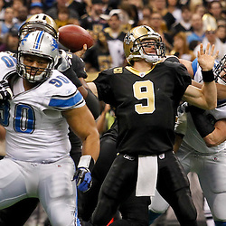 January 7, 2012; New Orleans, LA, USA; New Orleans Saints quarterback Drew Brees (9) is pressured by Detroit Lions defensive end Kyle Vanden Bosch (93) during the 2011 NFC wild card playoff game at the Mercedes-Benz Superdome. Mandatory Credit: Derick E. Hingle-US PRESSWIRE