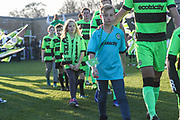 FGR ambassadors lead the team out during the EFL Sky Bet League 2 match between Forest Green Rovers and Morecambe at the New Lawn, Forest Green, United Kingdom on 17 November 2018.