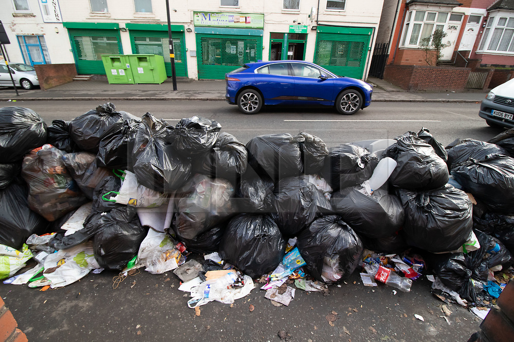 © Licensed to London News Pictures. 20/02/2019. Birmingham, UK. Birmingham bin men work to rule. Pictured, large amounts of uncollected rubbish outside houses on the main Bordesley Green Road in Small Heath. Industrial action by Birmingham waste collection services is resulting in a build up of rubbish on the streets in areas of the City. Photo credit: Dave Warren/LNP