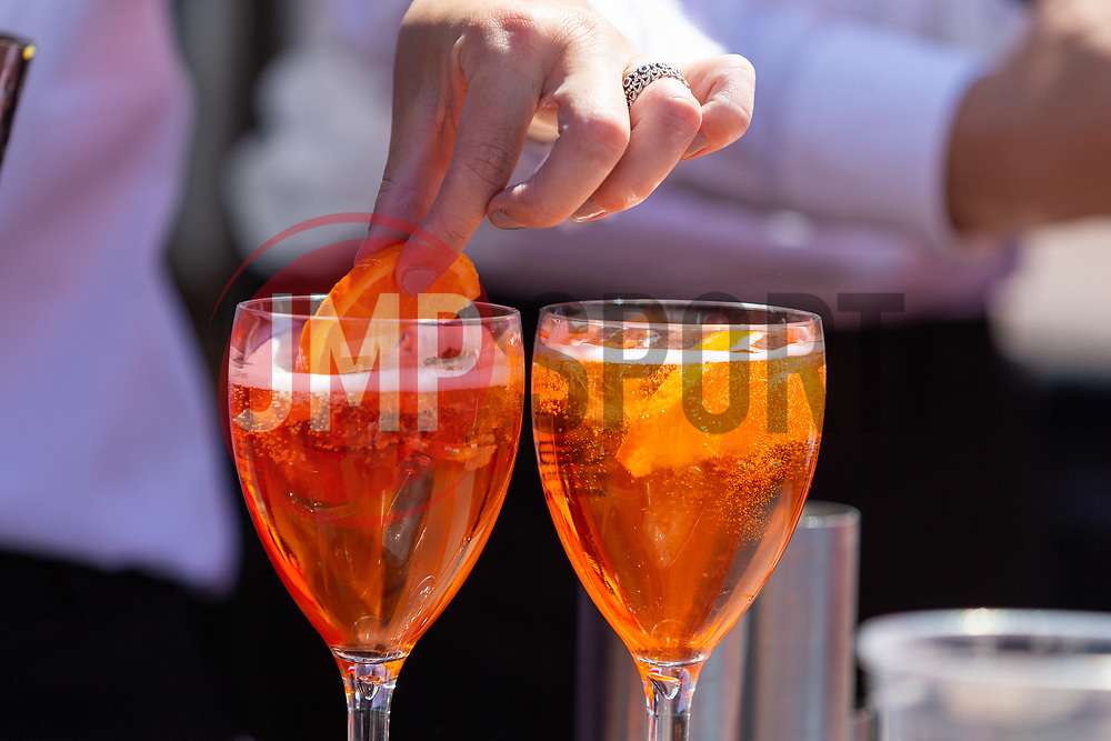 A slice of orange is added to a glass of asperol - Ryan Hiscott/JMP - 07/07/2018 - FOOTBALL - Ashton Gate - Bristol, England - Sweden v England, World Cup Quarter Final, World Cup Village at Ashton Gate