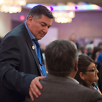 Senator George Muñoz walks around the dinner tables greeting people, Thursday, during the McKinley County-Gallup Day Gala Reception in Santa Fe.