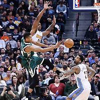 03 February 2016: Milwaukee Bucks forward Giannis Antetokounmpo (34) passes the ball past Denver Nuggets forward Darrell Arthur (00) over Denver Nuggets forward Wilson Chandler (21) during the Denver Nuggets 121-117 victory over the Milwaukee Bucks, at the Pepsi Center, Denver, Colorado, USA.