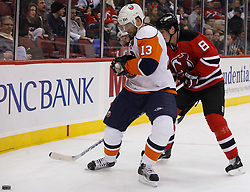 November 16, 2007; Newark, NJ, USA; New York Islanders right wing Bill Guerin (13) and New Jersey Devils defenseman Sheldon Brookbank (8) battle along the boards during the third period at the Prudential Center in Newark, NJ.