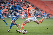 Goal scorer, Kyle Vassell (Blackpool) takes a shot as Liam Donnelly (Hartlepool United) tries to close him down during the EFL Sky Bet League 2 match between Blackpool and Hartlepool United at Bloomfield Road, Blackpool, England on 25 March 2017. Photo by Mark P Doherty.