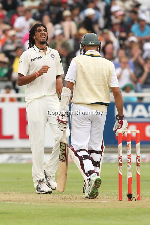 CAPE TOWN, SOUTH AFRICA - 2 January 2011, Ishant Sharma of India looks at Hushim Amla of South Africa after he edged a delivery through the slips for four runs during day 1 of the 3rd Castle Test between South Africa and India held at Sahara Park Newlands Stadium in Cape Town, South Africa on the 2 January 2011 .Photo by: Shaun Roy
