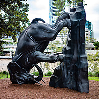 New Zealand artist Michael Parekowhai depicts a large bookend with an elephant tipped on its head and a native water rat looking the larger animal in the eye