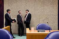 Nederland. Den Haag, 18 februari 2010.<br /> Rouvoet, Bos en Balkenende overleggen in vak K.<br /> Spoeddebat in de Tweede Kamer over de ontstane crisissituatie binnen het kabinet over Uruzgan, daags voor de val van het vierde kabinet Balkenende.<br /> Foto Martijn Beekman