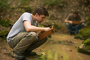 Ohio University student Daniel Williams looks for bone fragments at Archaeology Field School. Photo by Ben Siegel