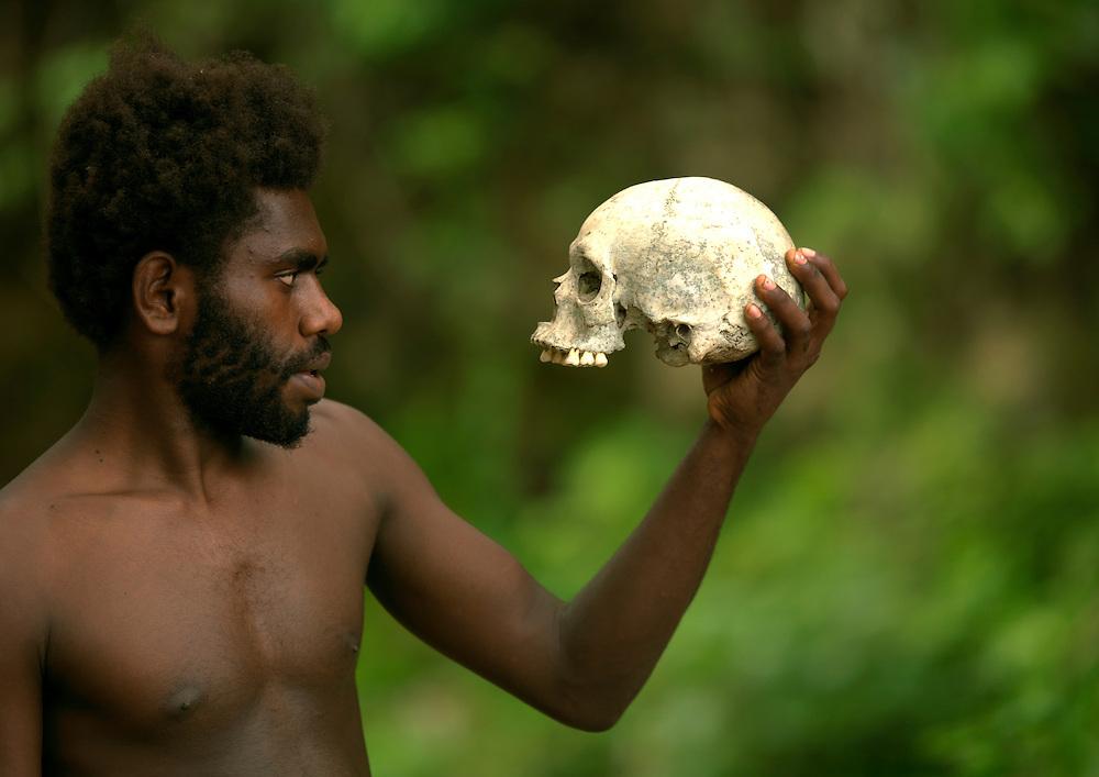 Vanuatu, Malampa Province, Malekula Island, man holding a human skull
