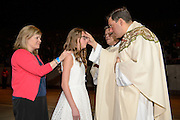 DENVER, CO - MAY 7:  Candidates get confirmed during the Archdiocese of Denver's inaugural Sealed and Sent event at the Denver Coliseum  on May 7, 2016 in Denver, Colorado. (Photo by Anya Semenoff for the Archdiocese of Denver)