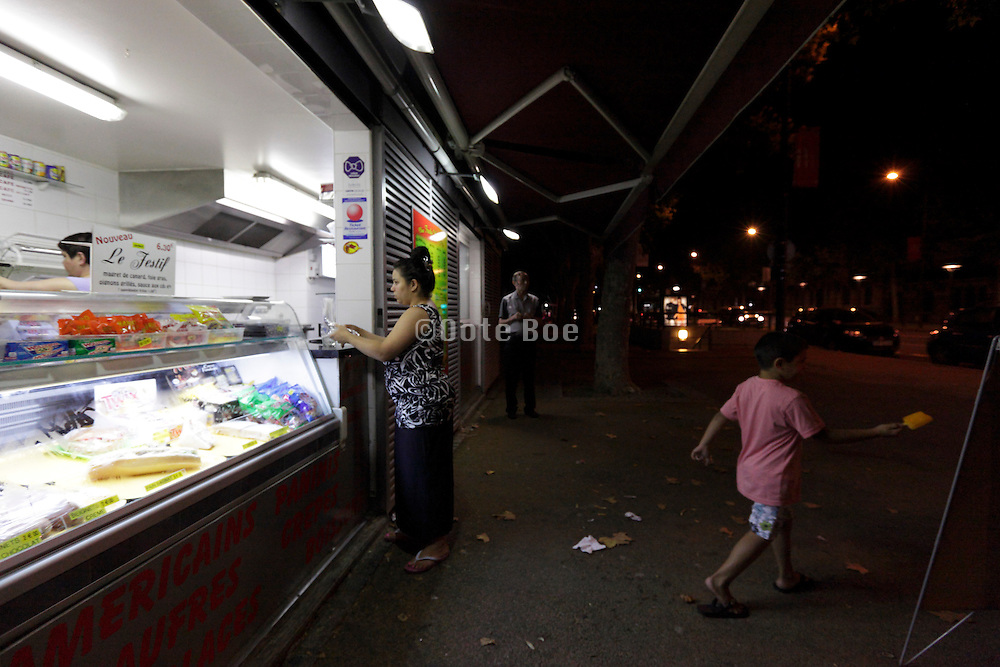 snack bar with people ordering food late at night