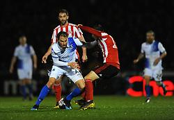 Edward Upson of Bristol Rovers is tackles by Lewis Morgan of Sunderland- Mandatory by-line: Nizaam Jones/JMP - 05/03/2019 - FOOTBALL - Memorial Stadium - Bristol, England - Bristol Rovers v Sunderland - Checkatrade Trophy