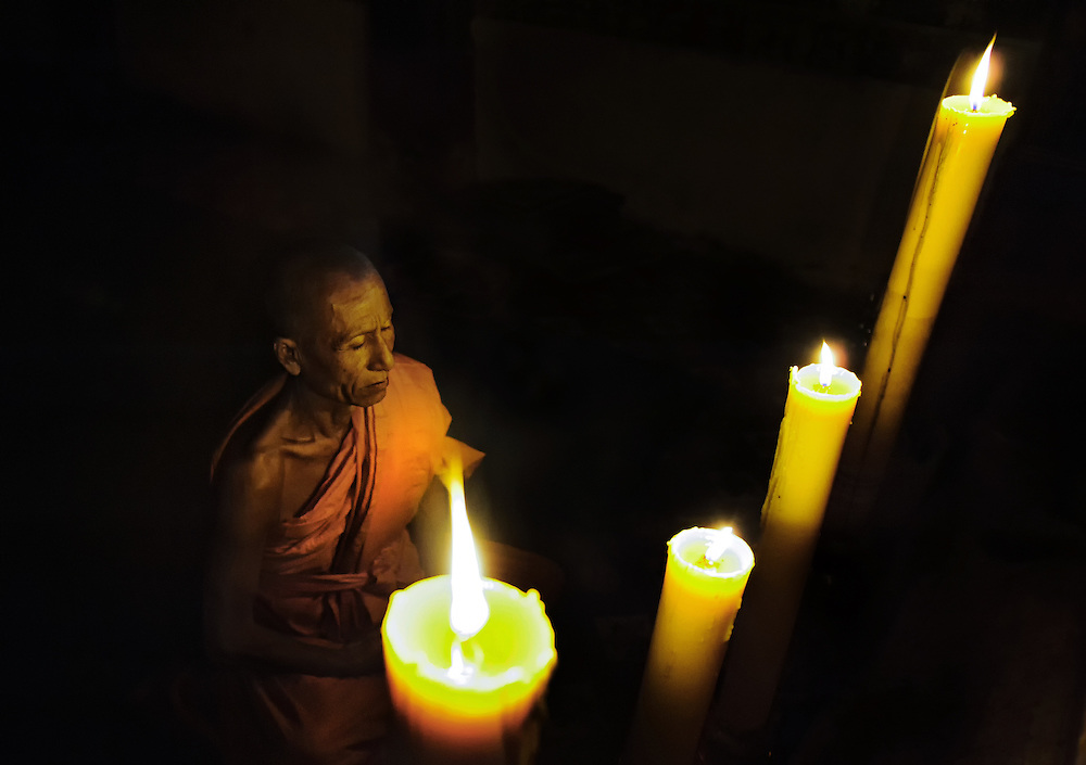 A monk in his Wat near Luang Prabang, Laos.