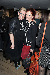 Left to right, KATE HALFPENNY and EMILIA FOX at the launch of 'She Died of Beauty' as part of London Fashion Week Autumn/Winter 2012 held at The Club at The Ivy Club, London on 17th February 2012.