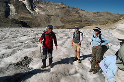 Switzlerland: Hiking the Swiss Glaciers near St. Moritz, taking the Diavolezza Morteratsch hike..Hikers on Pers Glacier..Photo copyright Lee Foster, 510/549-2202, lee@fostertravel.com, www.fostertravel.com..Photo #: swisse11473