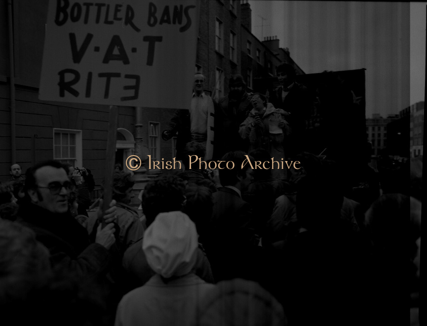 "Irish Theatre Industry Protest at Leinster House.1983.07.12.1983.12.07.1983.7th December 1983...With the imposition of a 23% V.A.T.rate on theatre tickets, the theatre industry was feeling the strain. Maureen potter and Brendan Grace aka ""Bottler"" led the protest to the gates of Leinster House Dublin"