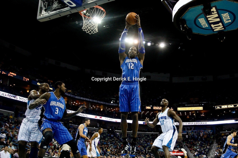 January 27, 2012; New Orleans, LA, USA; Orlando Magic center Dwight Howard (12) rebounds against the New Orleans Hornets during the first half of a game at the New Orleans Arena.   Mandatory Credit: Derick E. Hingle-US PRESSWIRE
