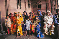 An Indian family dressed in their finest clothes for a visit to Fatehpur Sikri in the city of Agra, Uttar Pradesh, India.