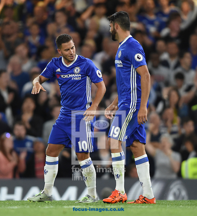 Chelsea's Eden Hazard celebrates scoring their first goal from the penalty spot with Diego Costa during the Premier League match at Stamford Bridge, London<br /> Picture by Daniel Hambury/Focus Images Ltd +44 7813 022858<br /> 15/08/2016