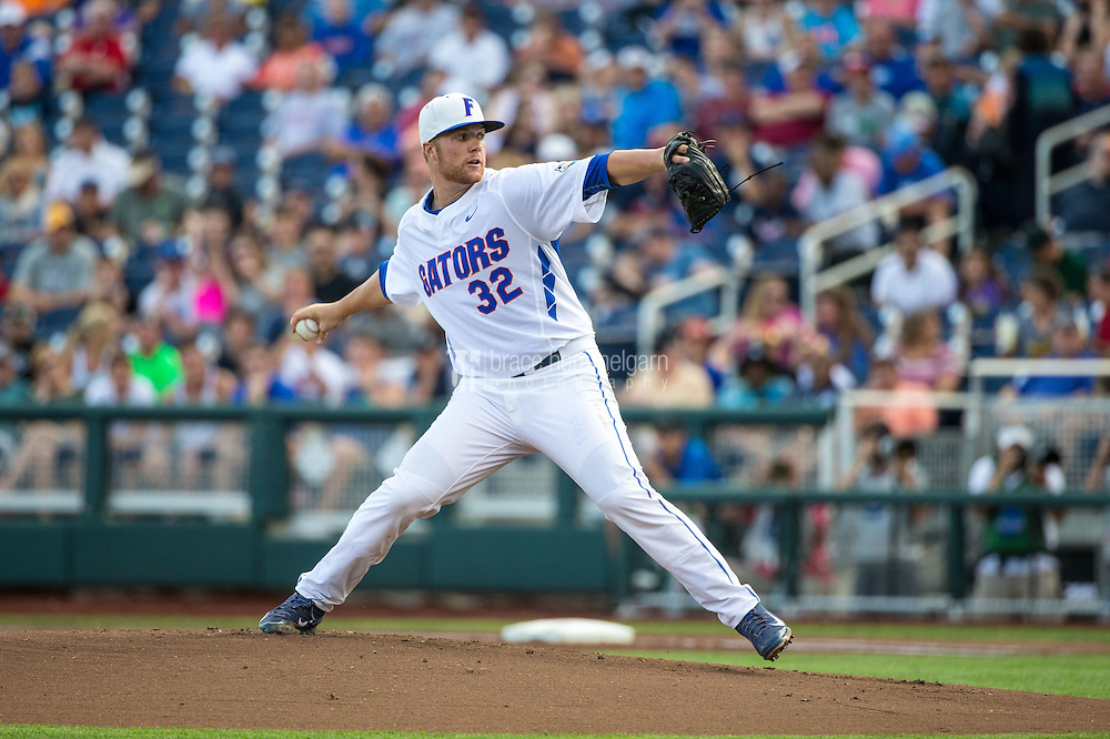 Logan Shore (32) of the Florida Gators pitches during a game between the Miami Hurricanes and Florida Gators at TD Ameritrade Park on June 13, 2015 in Omaha, Nebraska. (Brace Hemmelgarn)
