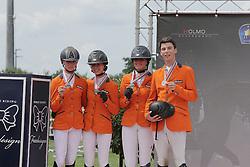 Team Netherlands : Kim Hoogenraat, Kim Brtil, Demi van Grunsven, Jens van Grunsven, chef d'equipe Roelof Bril<br /> FEI European Jumping Championship for juniors <br /> Arezzo 2014<br /> © Hippo Foto - Stefano Secchi