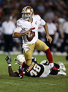 San Francisco 49ers quarterback Christian Ponder (5) rolls left as he looks to pass during the 2016 NFL preseason football game against the San Diego Chargers on Thursday, Sept. 1, 2016 in San Diego. The 49ers won the game 31-21. (©Paul Anthony Spinelli)